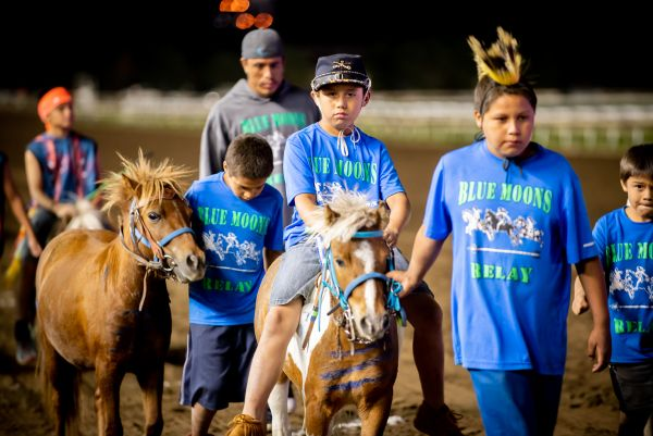 Youth riders from Blue Moons Relay presenting horses.