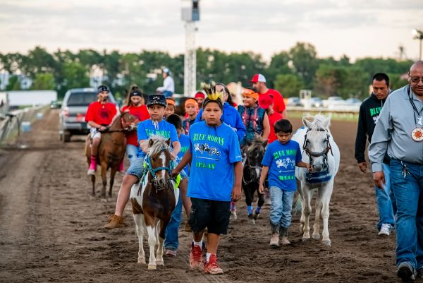 Youth riders from Blue Moons Relay walking ponies to starting point.